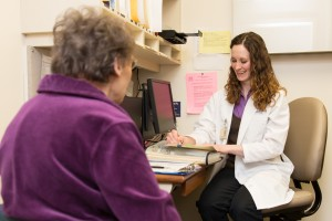 U-M Dietitian Sarah Radke works with a patient to determine nutritional needs.