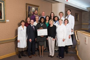 Paul Morning of the ALS Association Michigan presents a check to the University of Michigan Comprehensive ALS Clinic team.