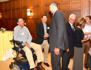 Photo of Juwan Howard, Bob Shoeni and Dr. Philip Choi