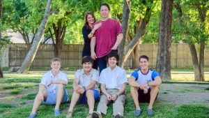 Tammy and Derek Wood, with sons Jace, Tyler, Connor and Kenneth.